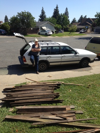 Loading redwood fence boards after helping to take down an old fence